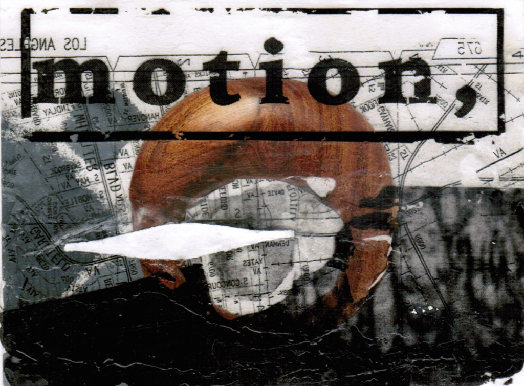 "layered collage with map and a wooden circle and the word ""motion"""