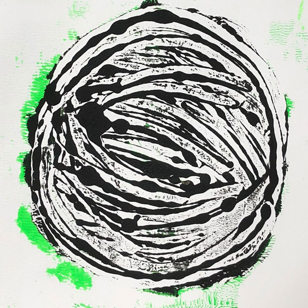monograph of black abstract planet with green edges