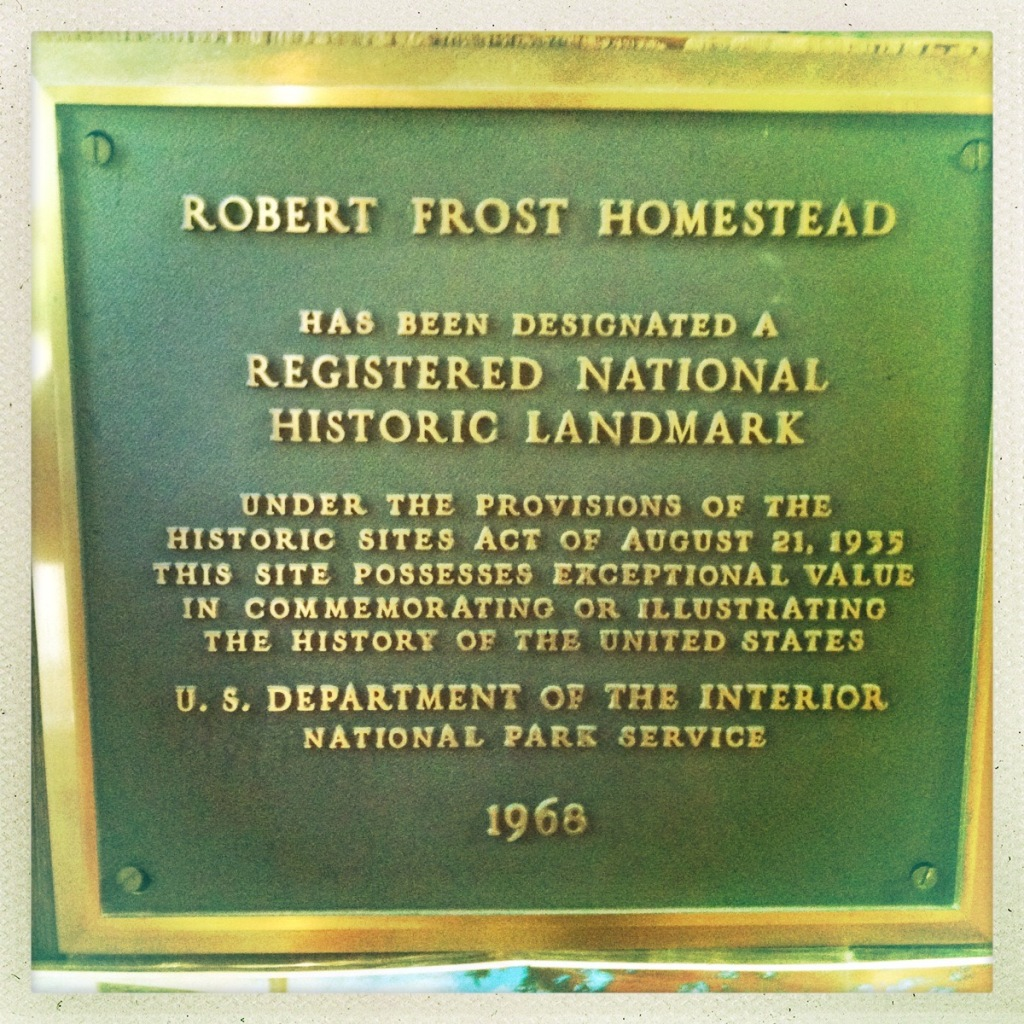 Color photo of a plaque registering the Robert Frost homestead as a national historic landmark