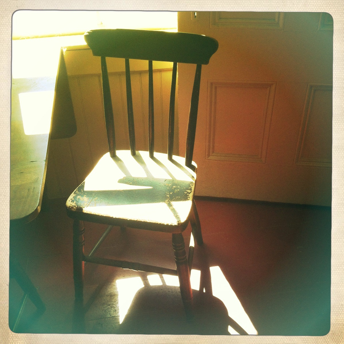 antique ladderback chair in the Frost farm kitchen